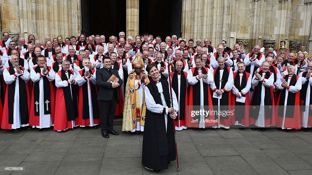 The Reverend <a gi-track='captionPersonalityLinkClicked' href=/galleries/search?phrase=Libby+Lane&family=editorial&specificpeople=1366183 ng-click='$event.stopPropagation()'>Libby Lane</a> smiles as she stands near the Archbishop of Canterbury, <a gi-track='captionPersonalityLinkClicked' href=/galleries/search?phrase=Justin+Welby&family=editorial&specificpeople=9960447 ng-click='$event.stopPropagation()'>Justin Welby</a>, (front row, 7th R) and the Archbishop of York, Dr <a gi-track='captionPersonalityLinkClicked' href=/galleries/search?phrase=John+Sentamu&family=editorial&specificpeople=623109 ng-click='$event.stopPropagation()'>John Sentamu</a> (front row, C) outside York Minster after she was consecrated as the eighth Bishop of Stockport on January 26, 2015 in York, England. The Church of England consecrated its first female bishop during a ceremony at York Minster today. The Reverend <a gi-track='captionPersonalityLinkClicked' href=/galleries/search?phrase=Libby+Lane&family=editorial&specificpeople=1366183 ng-click='$event.stopPropagation()'>Libby Lane</a>, who has been the vicar of St Peter's Hale and St Elizabeth's Ashley, in Greater Manchester, was ordained as the new Bishop of Stockport in a two hour service led by the Archbishop of York, Dr <a gi-track='captionPersonalityLinkClicked' href=/galleries/search?phrase=John+Sentamu&family=editorial&specificpeople=623109 ng-click='$event.stopPropagation()'>John Sentamu</a>.