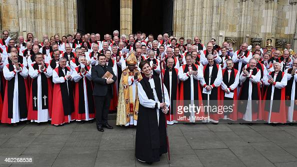 The Reverend Libby Lane smiles as she stands near the Archbishop of Canterbury Justin Welby and the Archbishop of York Dr John Sentamu outside York...
