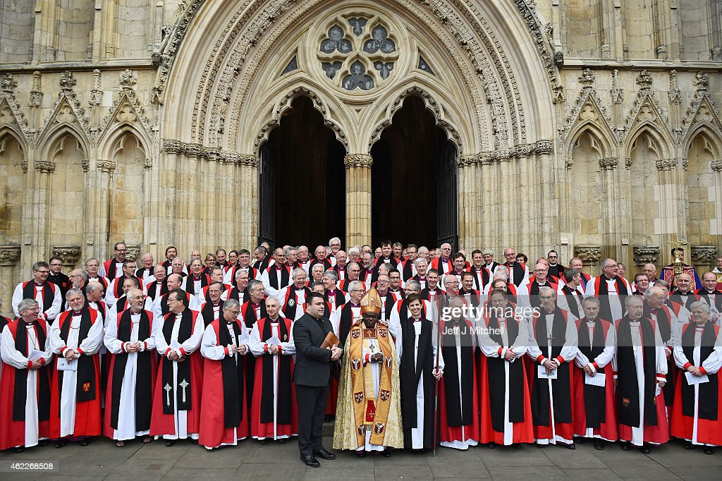 The Reverend Libby Lane smiles as she stands next to the Archbishop of Canterbury, Justin Welby, (front row, 6th R) and the Archbishop of York, Dr John Sentamu (front row, C) outside York Minster after she was consecrated as the eighth Bishop of Stockport on January 26, 2015 in York, England. The Church of England consecrated its first female bishop during a ceremony at York Minster today. The Reverend Libby Lane, who has been the vicar of St Peter's Hale and St Elizabeth's Ashley, in Greater Manchester, was ordained as the new Bishop of Stockport in a two hour service led by the Archbishop of York, Dr John Sentamu.