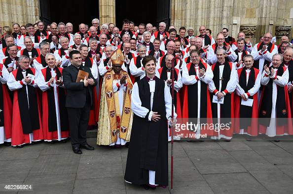 The Reverend Libby Lane smiles as she stands with the Archbishop of York Dr John Sentamu and the Archbishop of Canterbury Justin Welby outside York...