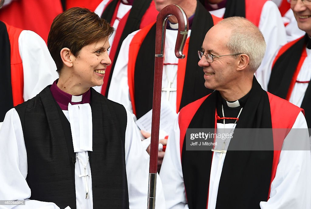 The Reverend <a gi-track='captionPersonalityLinkClicked' href=/galleries/search?phrase=Libby+Lane&family=editorial&specificpeople=1366183 ng-click='$event.stopPropagation()'>Libby Lane</a> smiles at the Archbishop of Canterbury, <a gi-track='captionPersonalityLinkClicked' href=/galleries/search?phrase=Justin+Welby&family=editorial&specificpeople=9960447 ng-click='$event.stopPropagation()'>Justin Welby</a> outside York Minster after she was consecrated as the eighth Bishop of Stockport on January 26, 2015 in York, England. The Church of England consecrated its first female bishop during a ceremony at York Minster today. The Reverend <a gi-track='captionPersonalityLinkClicked' href=/galleries/search?phrase=Libby+Lane&family=editorial&specificpeople=1366183 ng-click='$event.stopPropagation()'>Libby Lane</a>, who has been the vicar of St Peter's Hale and St Elizabeth's Ashley, in Greater Manchester, was ordained as the new Bishop of Stockport in a two hour service led by the Archbishop of York, Dr John Sentamu.