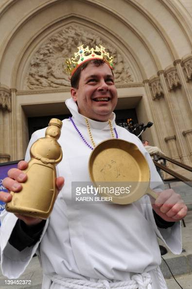 The Reverend Matthew Hanisian of St Albans Parish holds the 'Golden Fry Pan' and the 'Golden Mrs Butterworth' syrup bottle February 21 2012 after...