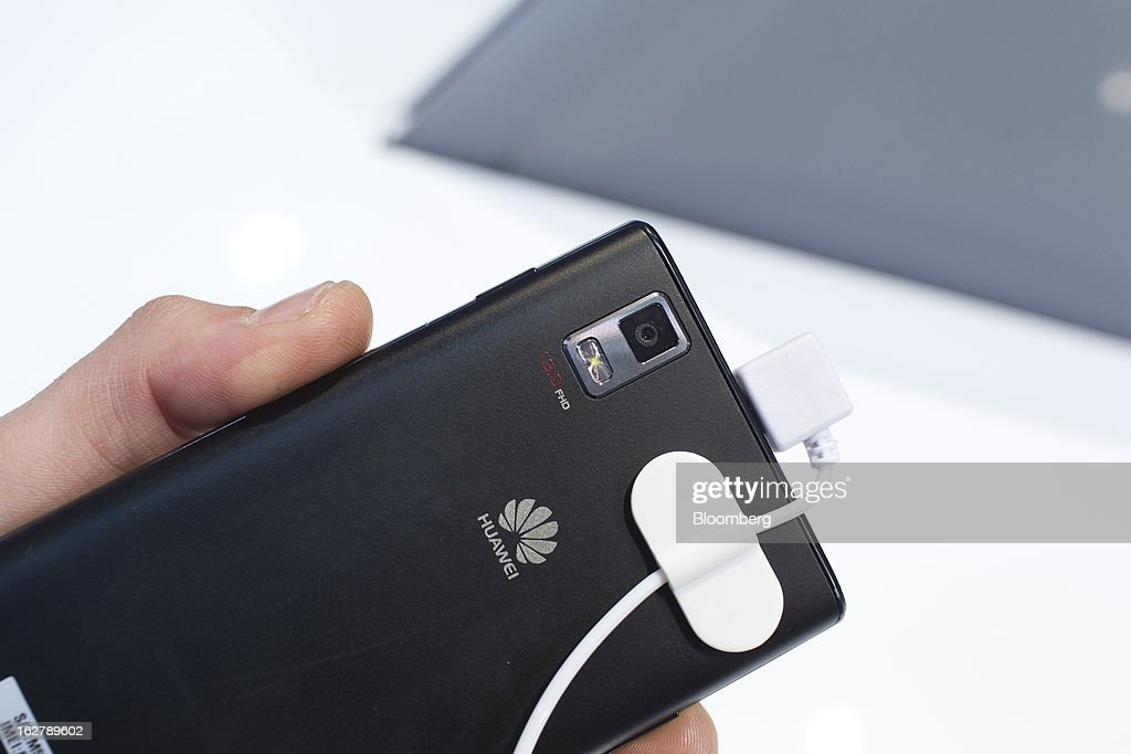 The reverse side of a Huawei Technologies Co. Ascend P2 smartphone is displayed for a photograph at the Mobile World Congress in Barcelona, Spain, on Wednesday, Feb. 27, 2013. The Mobile World Congress, where 1,500 exhibitors converge to discuss the future of wireless communication, is a global showcase for the mobile technology industry and runs from Feb. 25 through Feb. 28. Photographer: Angel Navarrete/Bloomberg via Getty Images