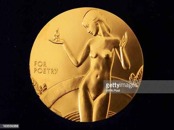The reverse side of the Queen's Gold Medal for Poetry as Queen Elizabeth II holds a audience with the Queen's Gold Medal for Poetry winner Mr John...