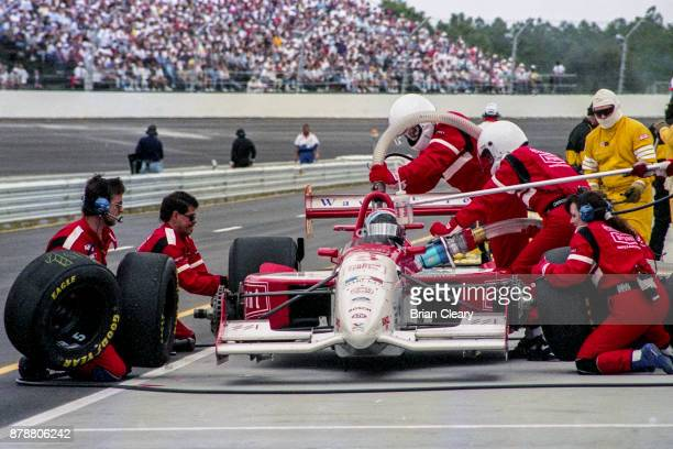 The Reynard Cosworth of Arie Luyendyk makes a pit stop during the Indy 200 Indy Racing League IRL race at Walt Disney World Speedway Speedway on...