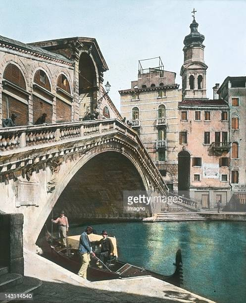 The Rialto Bridge seen from the right bank of the Grand Canal The most famous bridge spanning the canal in Venice with one arch with a width of 28...