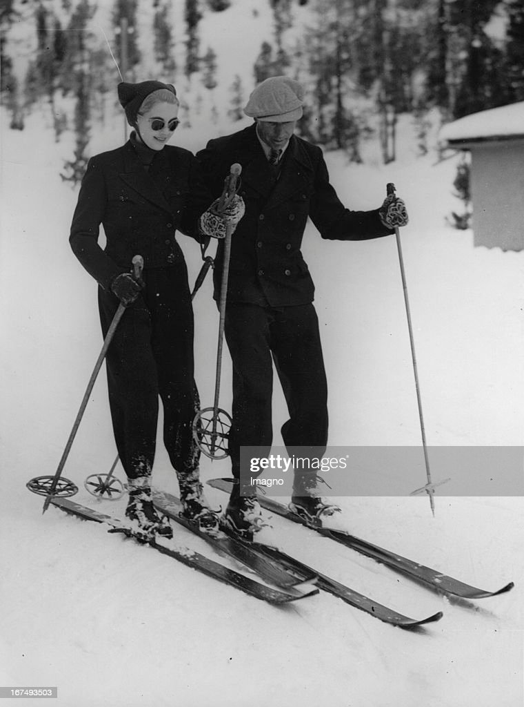 The rich American department store heiress <a gi-track='captionPersonalityLinkClicked' href=/galleries/search?phrase=Barbara+Hutton&family=editorial&specificpeople=930426 ng-click='$event.stopPropagation()'>Barbara Hutton</a> with her ski instructor in St. Moritz. 28th December 1937. Photograph. (Photo by Imagno/Getty Images) Die reiche US-amerikanische Kaufhaus-Erbin <a gi-track='captionPersonalityLinkClicked' href=/galleries/search?phrase=Barbara+Hutton&family=editorial&specificpeople=930426 ng-click='$event.stopPropagation()'>Barbara Hutton</a> mit ihrem Skilehrer in St. Moritz. 28. Dezember 1937. Photographie.