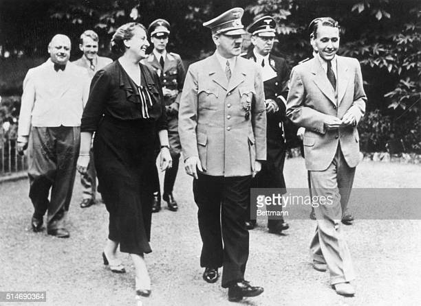 The Richard Wagner's Daughterinlaw escorts Adolf Hitler through the gardens of Wahnfried house during the annual Bayreuth Festival