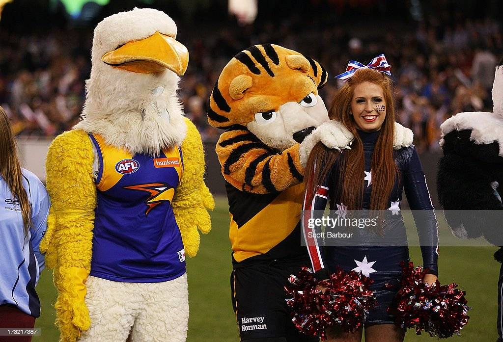 The Richmond Tigers mascot massages a cheerleader during the EJ Whitten Legends AFL game between Victoria and the All Stars at Etihad Stadium on July 10, 2013 in Melbourne, Australia.
