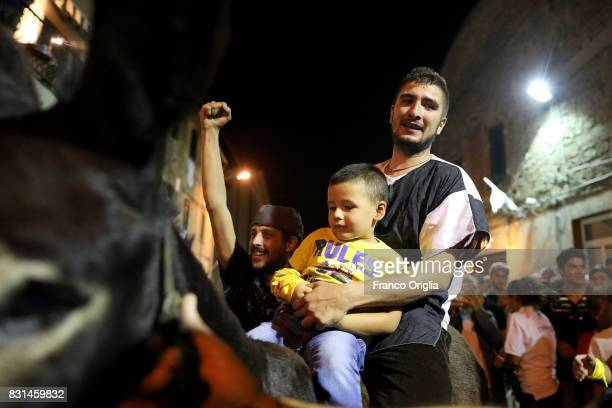 The rider of the Tramonto contrada jubilates as he wins the 87th Palio dei Ciuchi on August 14 2017 in Roccatederighi Grosseto Italy Palio dei...