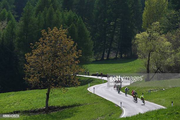 The riders descend from the Campo Carlo Magno towards the village of Dimaro during stage four of the Giro del Trentino from Val Daone to Monte...