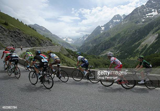 The riders in the breakaway make the climb of the Col du Lautaret during the fourteenth stage of the 2014 Tour de France a 177km stage between...