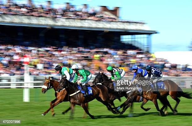 The riders in The Dawn Homes Ayrshire Favourites Racing Excellence Hand and Heels final Handicap hurdle race pass the main stand on the second day of...