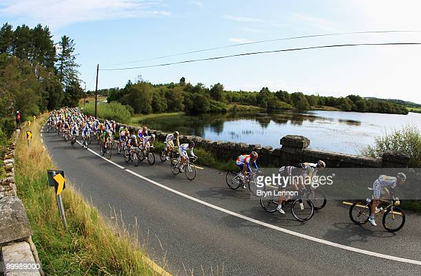 The riders make their way past a lake during Stage One of the 2009 Tour of Ireland from Enniskerry to Waterford on August 21 2009 in Waterford Ireland