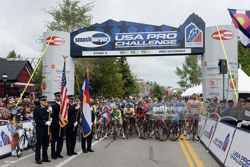 The riders stand for the playing of the National Anthem prior to the start of Stage Five of the USA Pro Challenge from Breckenridge to Colorado Springs on August 24, 2012 in Breckenridge, Colorado. Copyright 2012
