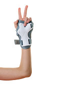 The right hand of the child dressed in protection isolated on a white background. Accessories for shock protection. Sports equipment.