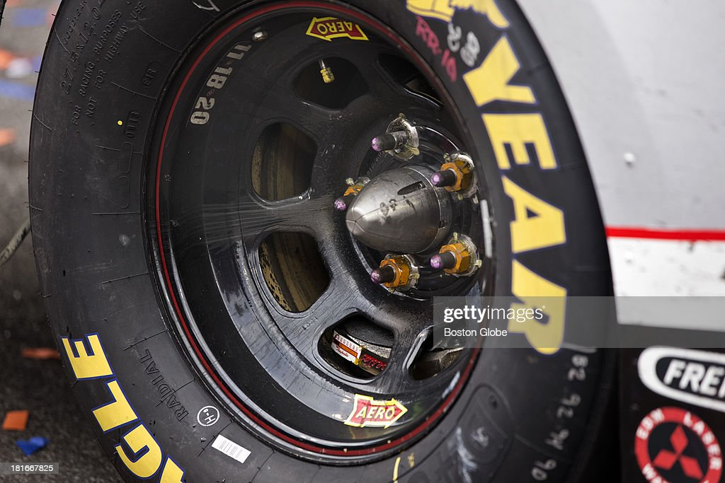 The right rear tire of Matt Kenseth's winning car in Victory Lane with a missing lug nut. The NASCAR Sprint Cup series Sylvania 300 took place at the New Hampshire Motor Speedway, Sunday, Sept. 22, 2013.