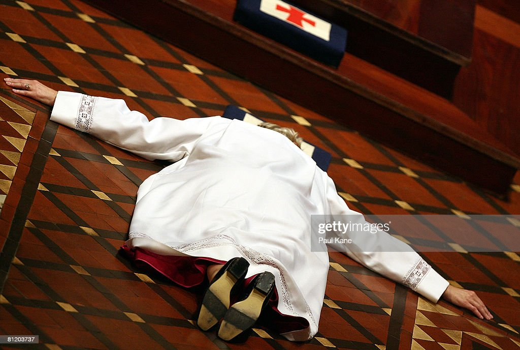 The Right Reverend Kay Goldsworthy lies on the ground before The Most Reverend Roger Herft Archbishop of Perth as he performs the consecration...