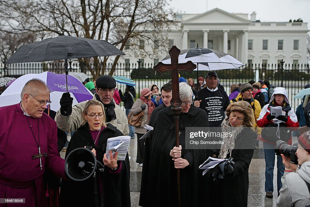 The Right Reverend Laura Aherns (2nd L), bishop suffragan of the Episcopal Diocese of Connecticut, leads prayers during the Stations of the Cross march and anti-violence demonstration outside the White House March 25, 2013 in Washington, DC. About 20 Episcopal bishops from throughout the church lead about 100 clergy and lay people in praying the Stations of the Cross as they processed along Pennsylvania Avenue from the White House to the U. S. Capitol. The march was organized 'to challenge violence, especially the epidemic of gun violence that claims so many thousands of American lives each year.'