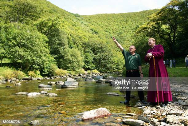 The Right Reverend Michael Langrish Bishop of Exeter and National Trust warden Julian Gurney lead residents of Lynton and Lynmouth along the East Lyn...