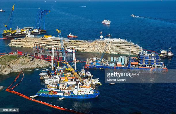 The right side of the Costa Concordia is seen on September 18 2013 in Isola del Giglio Italy The vessel which sank on January 12 was successfully...