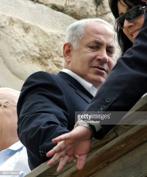 The rightwing Likud leader and former premier Benjamin Netanyahu looks down as he arrives at the at the Western Wall Judaism's holiest site 27 March...
