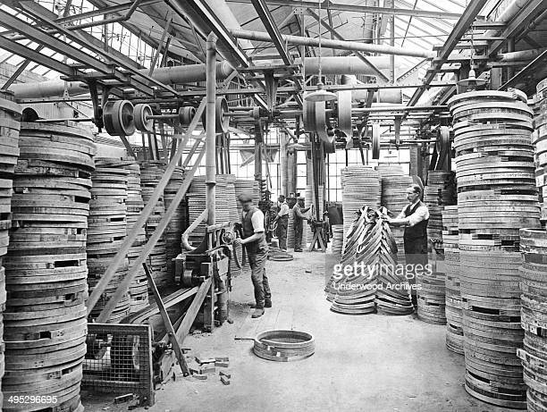 The rim department of a bicycle factory where they are shaped and colored April 1920