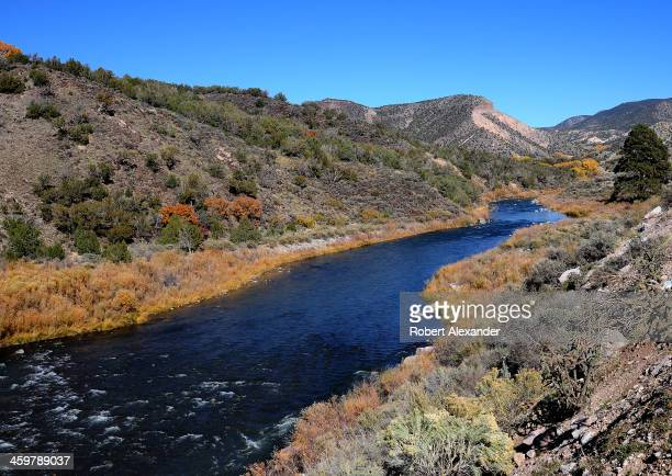 The Rio Grande River flows near Taos New Mexico The stretch of river and the gorge it carved into the desert landscape were designated the Rio Grande...
