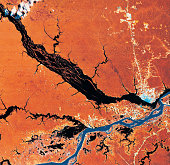 The Rio Negro river and the Rio Solimoes river joining to form the Amazon river, Brazil