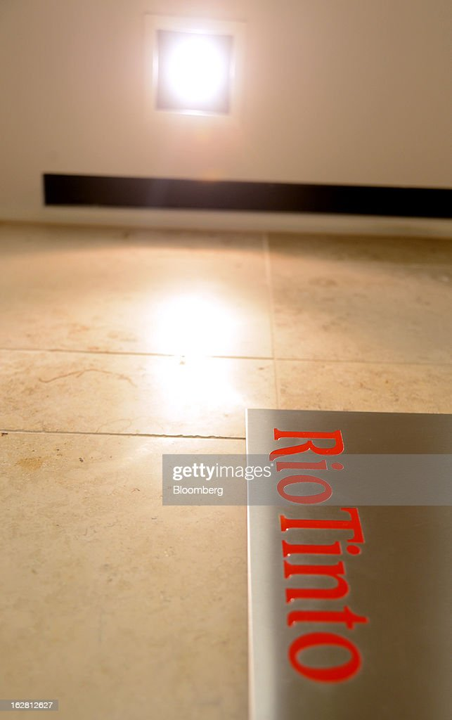 The Rio Tinto Group logo is mounted on a wall near the reception area of the company's offices in Melbourne, Australia, on Thursday, Feb. 28, 2013. Rio Tinto, the world's second-biggest mining company, named non-executive board director Christopher Lynch as chief financial officer to replace Guy Elliott who announced his retirement in July. Photographer: Carla Gottgens/Bloomberg via Getty Images