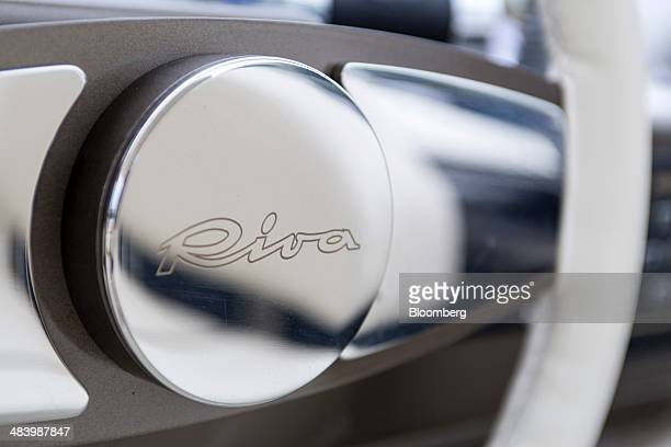 The Riva logo is displayed on the steering wheel of a Riva 75' Venere Super motor yacht manufactured by Ferretti Group at the Singapore Yacht Show in...