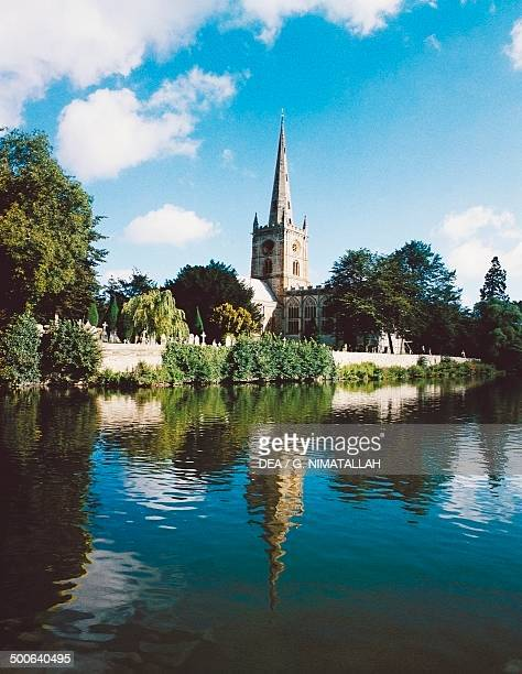 The River Avon and Holy Trinity Church where William Shakespeare was baptized and where he is buried StratforduponAvon England United Kingdom