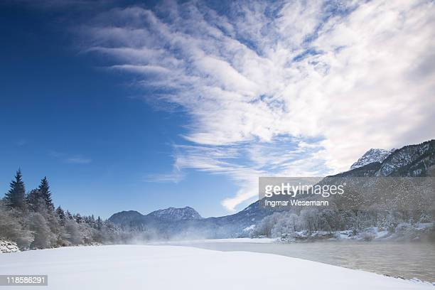 The river lech in winter with dramatic sky