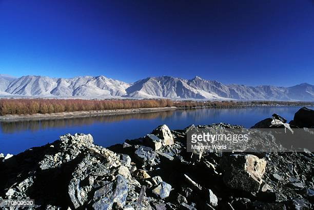 The river Lhasa and the Brahmaputra river locally known as Yarlung Tsang Bo meet near the Lhasa city Though trees grow next to the river the mountain...