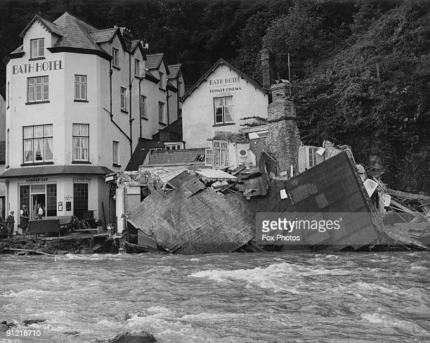 The River Lyn breaks its banks and flows through the town of Lynmouth in north Devon destroying parts of the Bath Hotel and other buildings 18th...