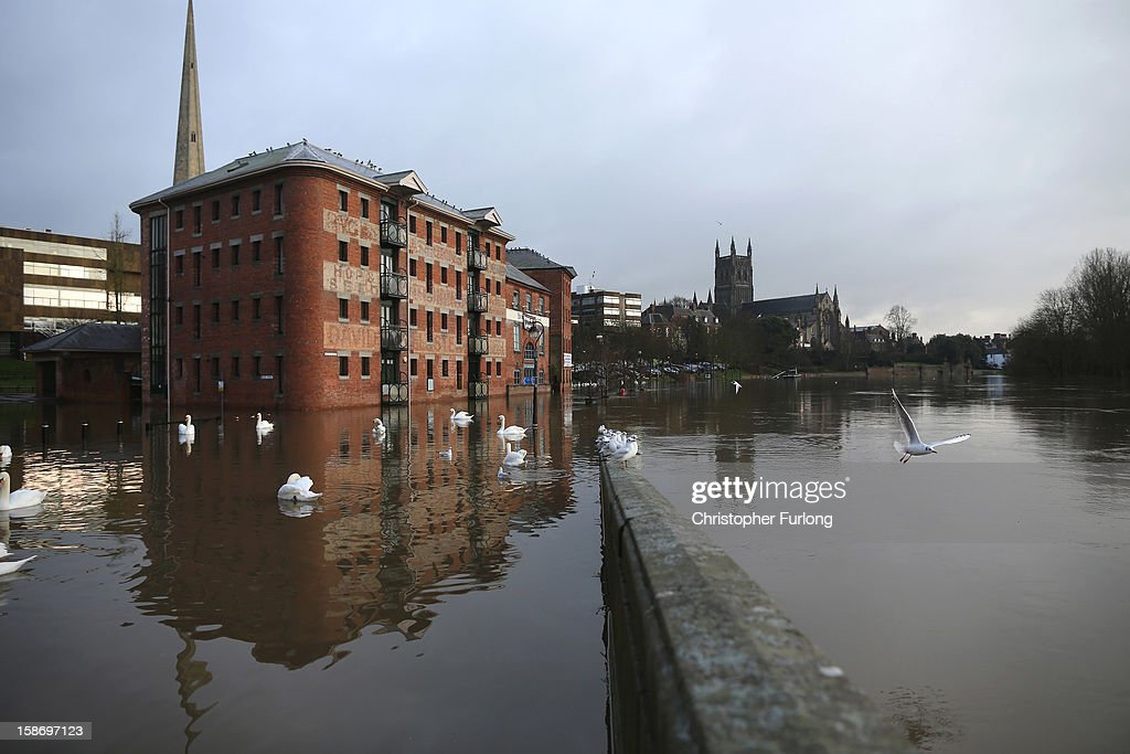 The River Severn breaks it's banks in the city of Worcester after heavy rainfall on December 24, 2012 in Worcester, England. Forecasters have predicted more rain to sweep across the country causing flash flooding over the coming days. The South West of England has been badly affected causing major disruption to the rail network delaying journeys for people making their way home for Christmas.