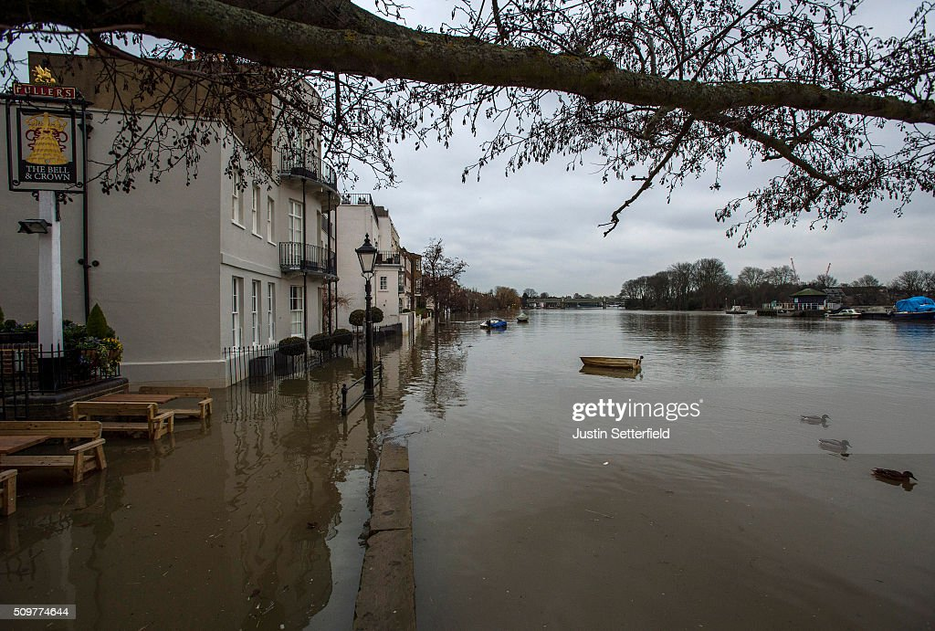 The River Thames bursts it's banks near Kew Bridge on February 12, 2016 in London, England. Flood alerts have been issued for a huge stretch of London after the Thames Barrier was closed yesterday for first time this winter after the river Thames burst it's banks due to massive tides and heavy rain.