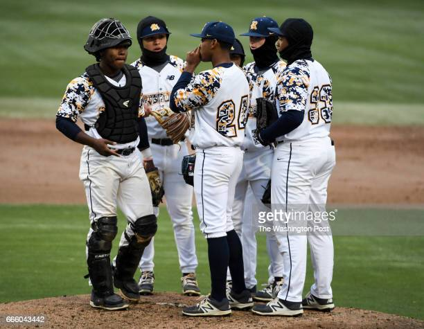 The Riverdale Baptist infield has a meeting with pitcher Harold Cortijo during action against DeMatha in Bowie MD on April 7 2017