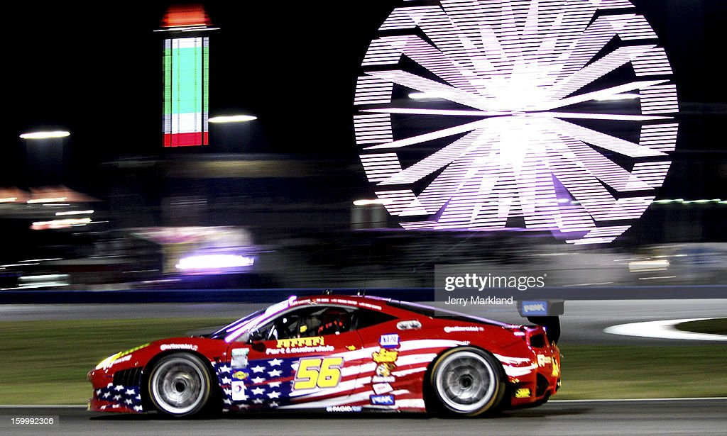 The #56 RK Motors Ferrari 458 driven by Robert Kauffamn, Rui Aguas, Michael Waltrip and Clint Bowyer during night practice for the Rolex 24 at Daytona International Speedway on January 24, 2013 in Daytona Beach, Florida.