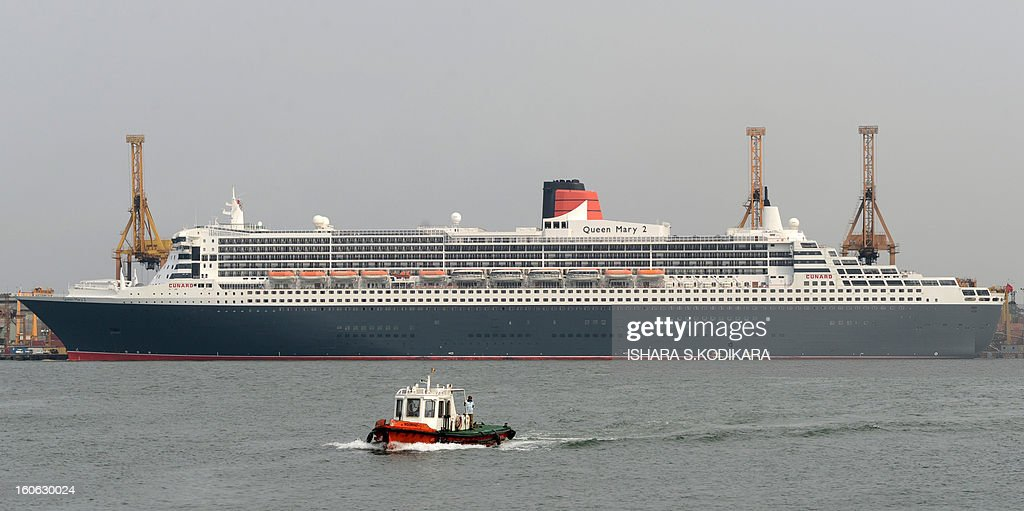 The RMS Queen Mary 2 is pictured during a brief stopover at the Colombo harbour on February 4, 2013. The luxury cruise liner brought over 2,300 tourists to Sri Lanka which is emerging from nearly four decades of ethnic war and has become an upmarket holiday destination. AFP PHOTO/ Ishara S