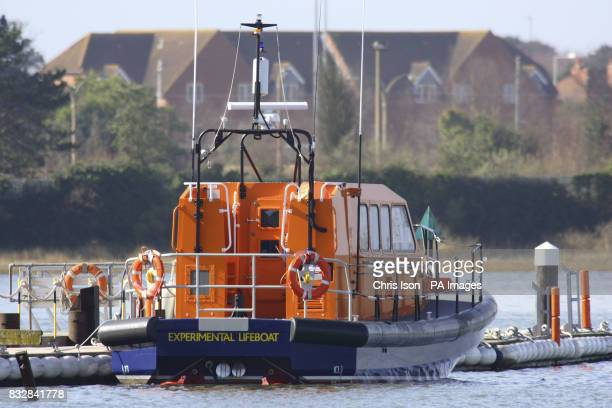 The RNLI's jet powered experamental Fast Carriage Boat 2 alongside at the charity's HQ in Poole Dorset The project aims to develop the replacement...