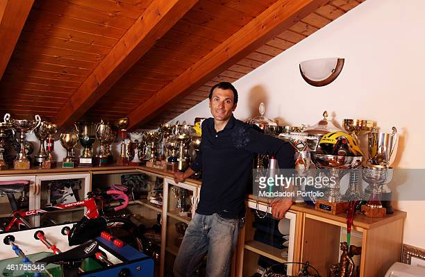 The road bicycle racer Ivan Basso during a photo shooting at home in the room where he keeps the trophies that he got in his career Cassano Magnago...