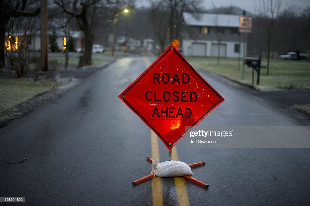 The road block seen on Juniata Valley Road in Blair County on December 21, 2012 in Frankstown Township, Pennsylvania. According to reports, a man shot and killed two men and one woman and injured three state troopers before being shot and killed by police along Juniata Valley Road in Frankstown Township.