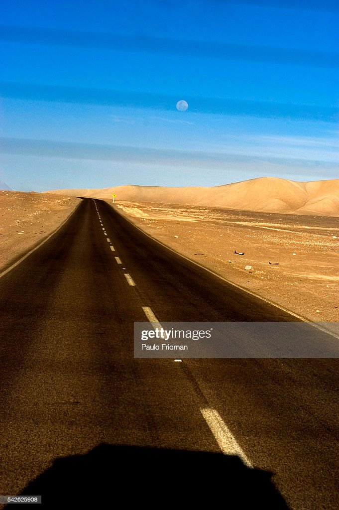 The road from the oasis of San Pedro de Atacama to Calama in the Atacama Desert in Chili The Atacama Desert crosses into parts of Peru Bolivia and...
