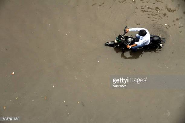 The road in front of Notre Toyenbee Circular Road went under kneedeep water after Wednesday's rain in Dhaka Bangladesh on August 2 2017