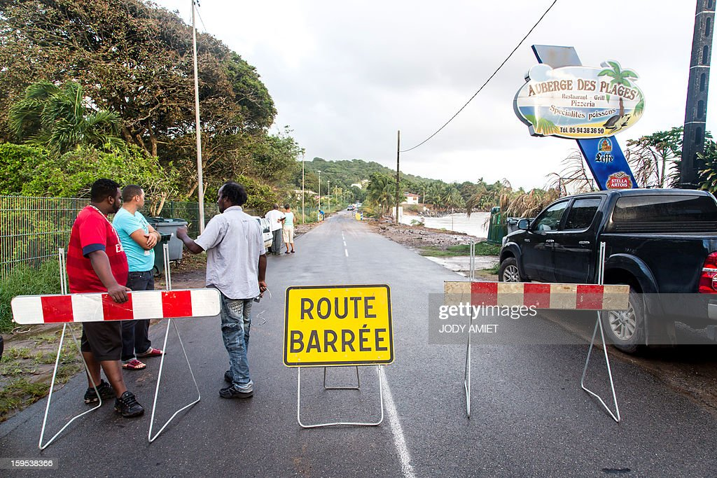 The road is closed along the sea as waves hit the coast near Cayenne on January 15, 2013. The coast of Guyana switched to 'red alert' today as several houses of Rémire-Montjoly (10 km from Cayenne) have been 'damaged' due to high tides, the prefecture of Guyana said in a statement.