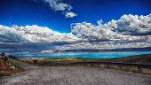 Blue Bear lake in the distance with thunderstorms and Garden City Utah USA.
