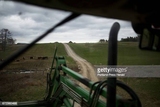 The road up to Arthur Randall Jr's house and barn seen through his tractor window