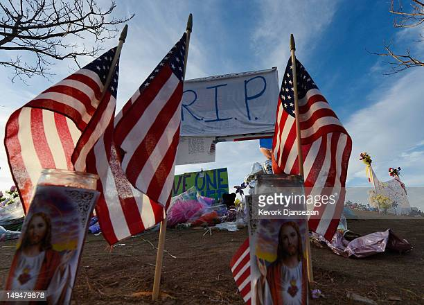 The roadside memorial set up for victims of the theaters shooting massacre across the street from Century 16 movie theater at sunrise July 29 2012 in...