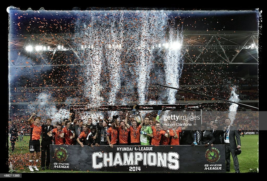 The Roar celebrate after they defeated the Wanderers in extra time to win the 2014 ALeague Grand Final match between the Brisbane Roar and the...